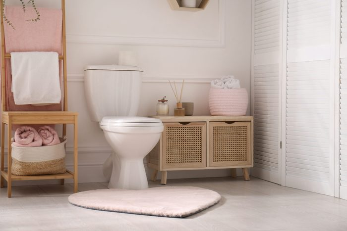 what happens if you hold your pee | Stylish,bathroom,interior,with,toilet,bowl,and,other,essentials
