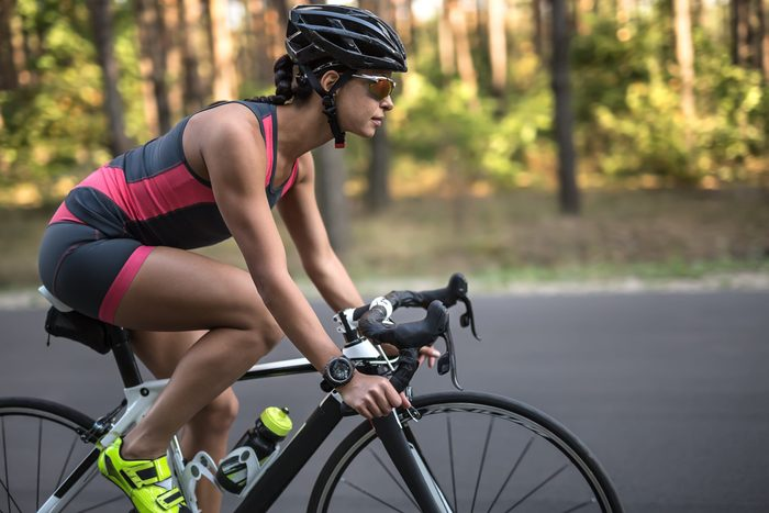 how to buy a bike helmet   Pretty,sportive,girl,rides,a,bike,on,the,road,on