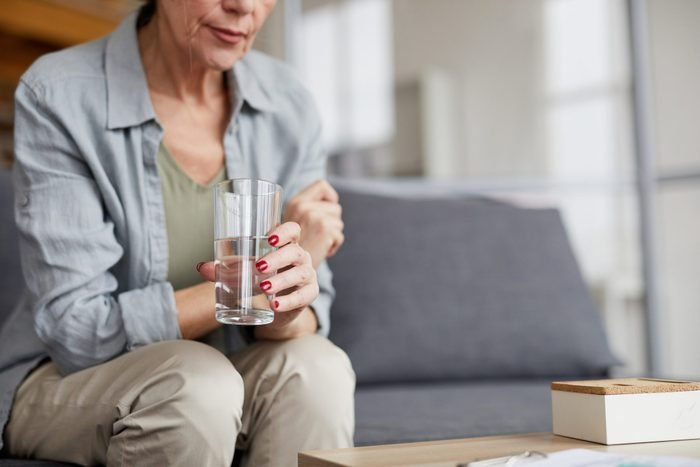 dehydration and anxiety | Worried Mature Woman Drinking Water