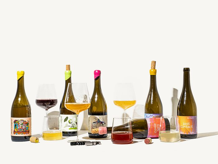 Acid League Wine Proxies   bottles of wine proxies with glasses next to them