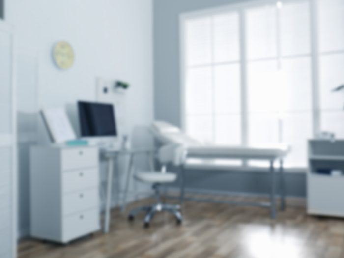 Blurred,view,of,modern,medical,office.,doctor's,workplace