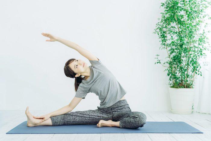 Young,asian,woman,doing,yoga.