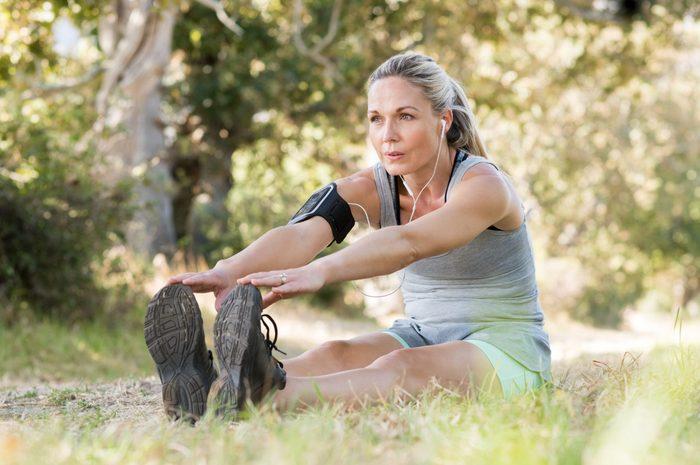 Senior,woman,exercising,in,park,while,listening,to,music.,senior