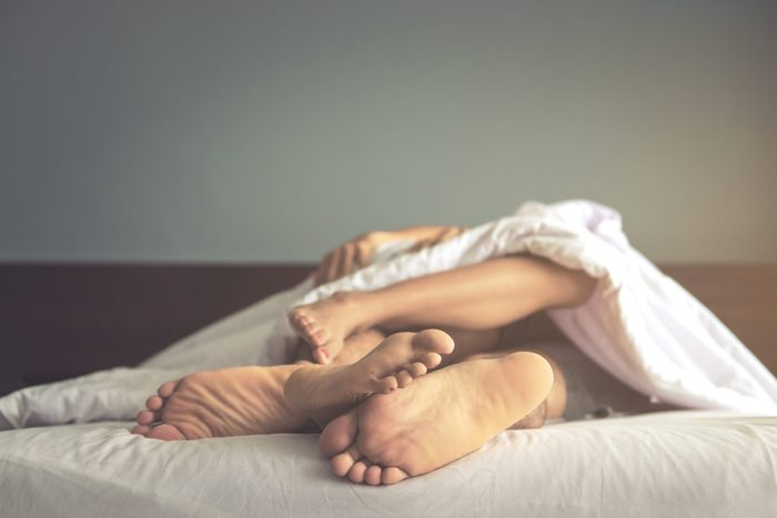 Close,up,of,feet,couple,having,sex,on,a,bed