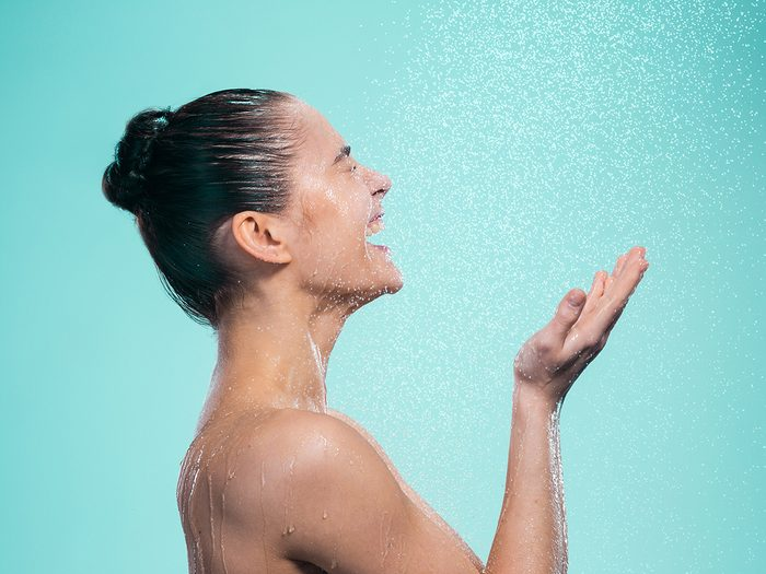 wash face in shower   Woman,enjoying,water,in,the,shower,under,a,shower,jet