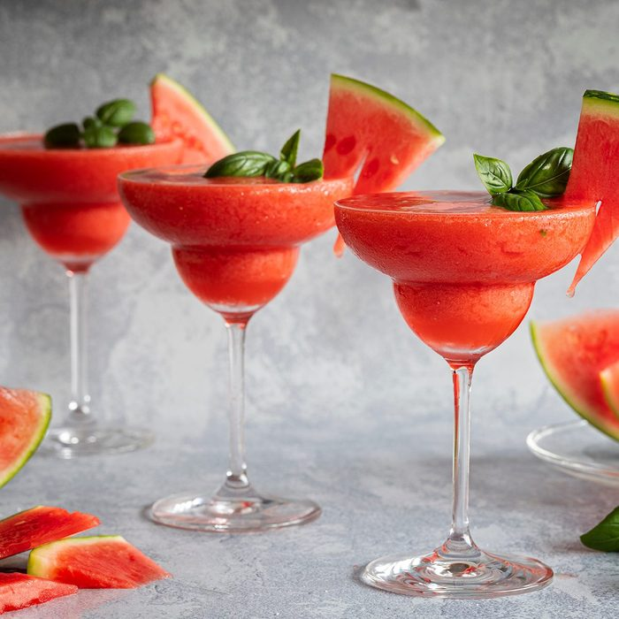 Frozen Red Drink Margarita Garnished With Watermelon And Basil. Three Red Drinks In A Row.