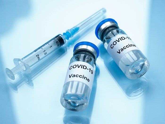 pfizer vs moderna   Two vials of COVID-19 vaccine