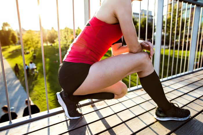 best compression socks   Young,runner,stretching,and,warming,up,in,park.