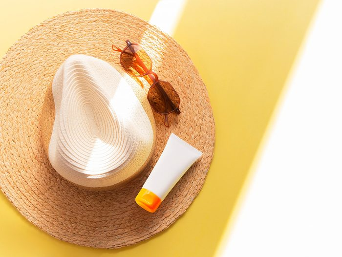 Sunprotection,objects.,straw,woman's,hat,with,sun,glasses,and,protection