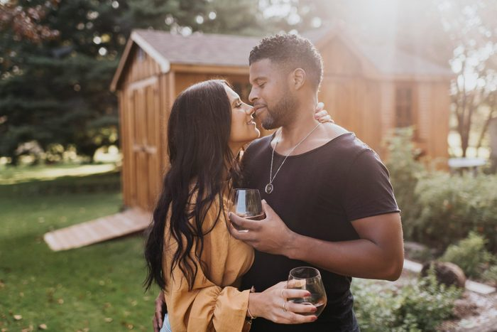 Couple Holding Wineglass While Doing Romance Standing At Backyard-love languages