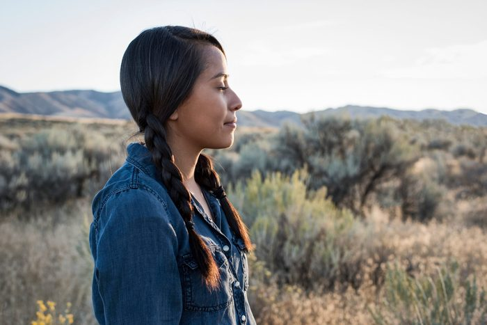 Young Native American Woman Outdoors At Sunset-setting intentions