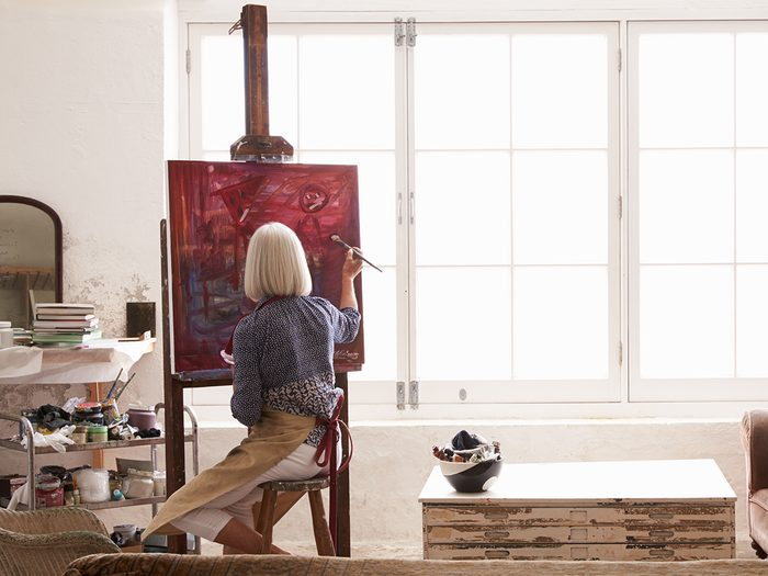 how to find a hobby | Female,artist,working,on,painting,in,bright,daylight,studio