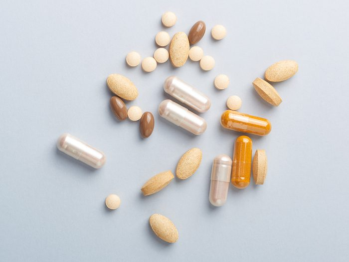 Multicolor,vitamins,and,supplements,on,bright,paper,background.,concept,for