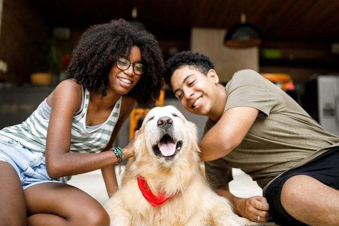 Two Teenagers With Their Dog