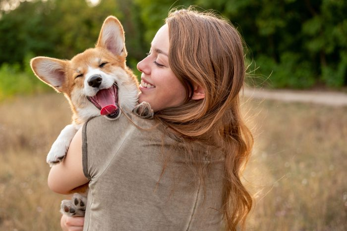 Portrait Young Woman With Laughing Corgi Puppy Nature Background