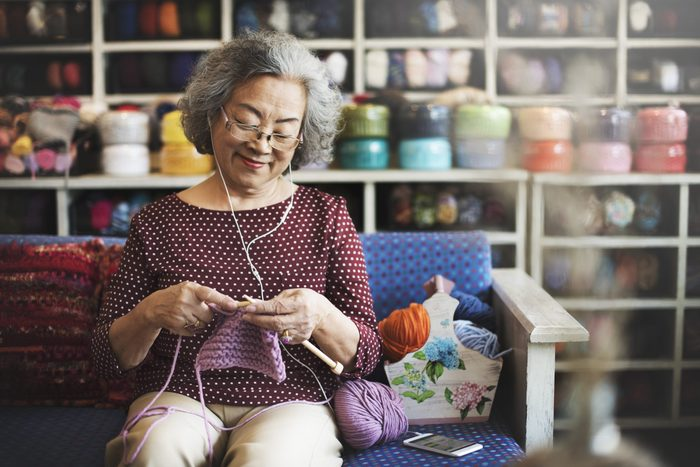 turn hobby into a side hustle | woman doing crochet