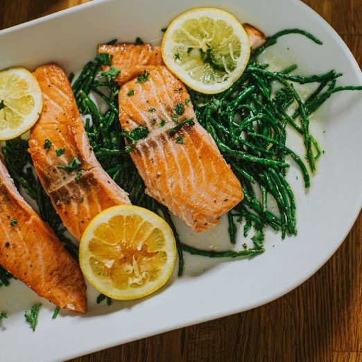 salmon benefits   Salmon On A Serving Plate On A Table