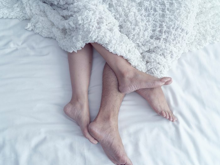 Lifestyle.,beautiful,couple,in,bed.,close,up,of,male,and