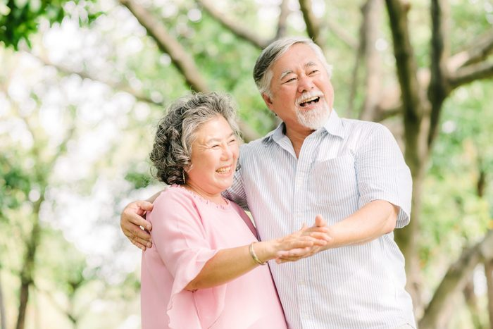 hip replacement exercise   senior couple dancing at the park